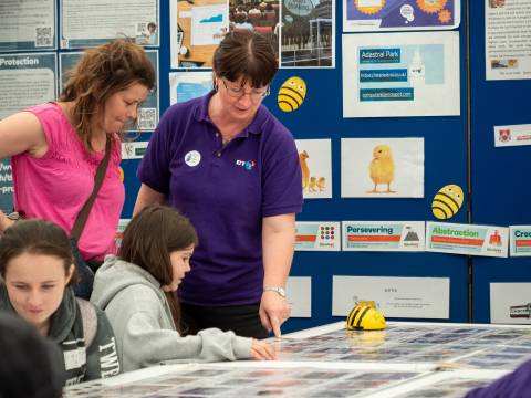 Visitors to BT Marquee learning about Beebots