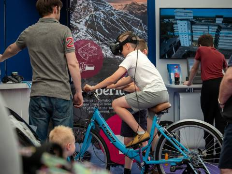 Visitor to BT Marquee on VR bike
